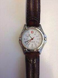 Swiss Army watch with brown leather bracelet