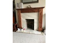 Marble fire surround complete with pine mantelpiece.
