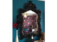 Large black ornate mirror