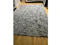 Grey long pile rug