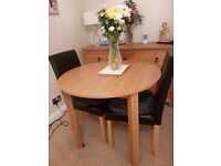 Dining table and 4 Leather look chairs