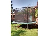12 foot Jump King trampoline in good condition with tent, new net, winter cover, steps and shoe net