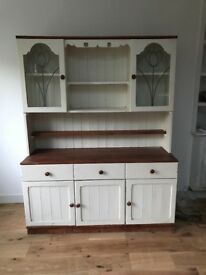 Lovely pine dresser. Off white with dark wood top and furnishings