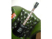 Vintage brand SG electric guitar copy with Wilkinsons pickups in black