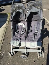 Used double buggy for sale. Still in good condition, comes with rain cover