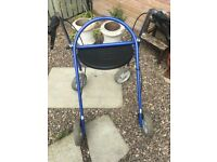 FOUR WHEEL WALKING AID WITH SEAT & BRAKES