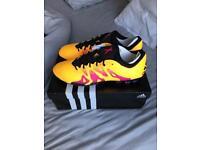 Men's Adidas X 15.1 AG football boots.