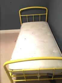 Yellow metal frame single bed