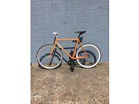Orange Iro (56 inch frame) fix wheel bike. Made in Staten Island NYC