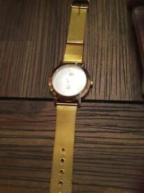 Gold coloured watch new