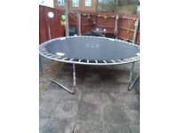 Trampoline 10ft for sale complete with enclosure less then a Year old with enclosure 50 pound