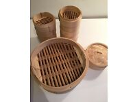 Mixed set of Asian bamboo steamers for dumplings