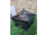 Heavy steel fire pit. Strong and good looking. With three bags of wood and heavy duty cover.