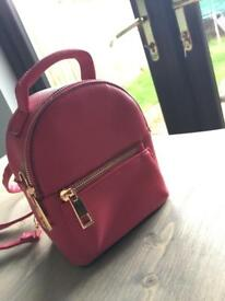 New look red mini back-pack never used