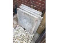 "4x 600mm/24"" square concrete paving slabs"