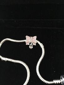 genuine pandora bracelet displayinge uropeon pink bow charm, charm only