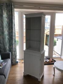 Shabby chic white cabinet has door that can be added