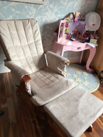 Nursing/Glider chair with matching foot stool.