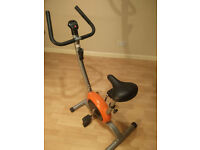 BodyFit exercise bike with digital display and adjustable resistance