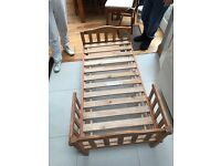 Two wooden toddler bed frames