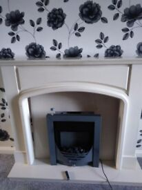 Cream wood fire suuround with fire,marble back and hearth