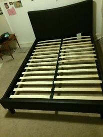 Double Bed (Frame only). Excellent condition. Black leather-look fabric covered. wooden slats.