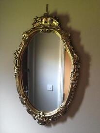 Lovely ornate gold frame oval mirror