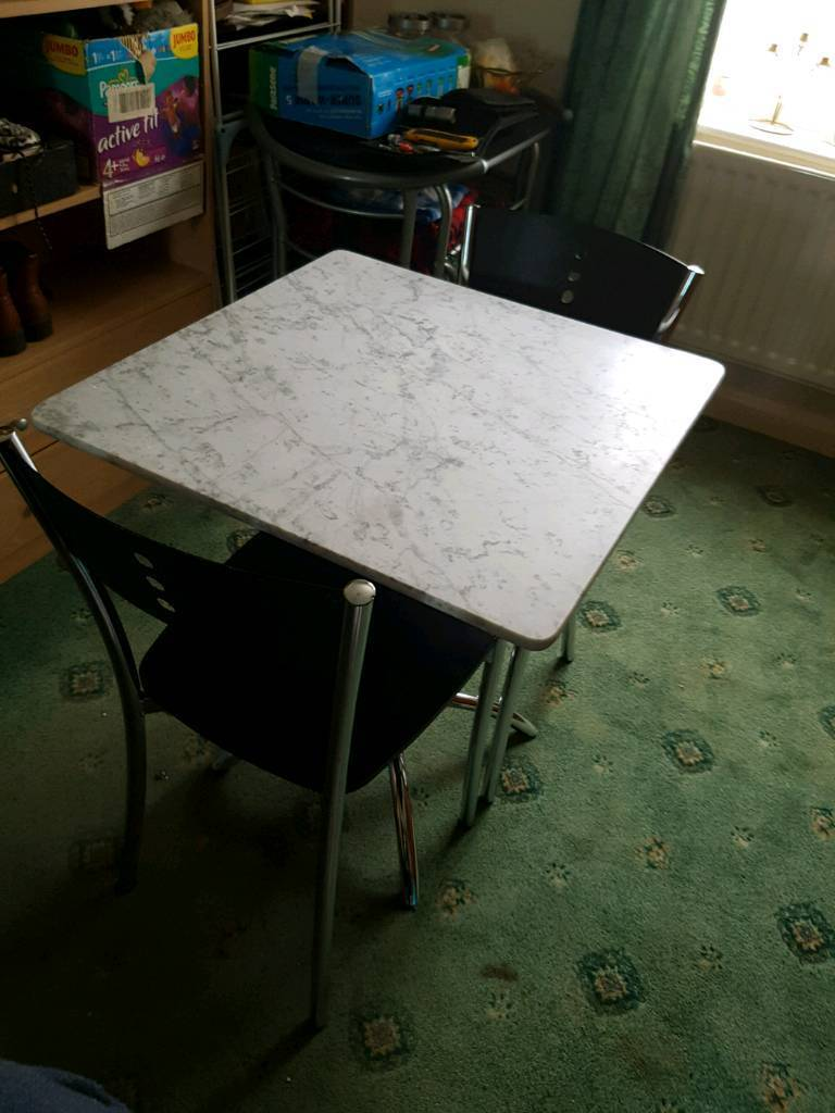 Marble table with chrome effect comes with 2x chairs