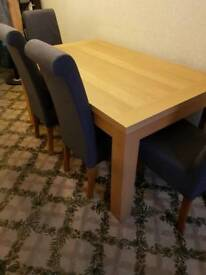 Wood dining table (for 6 people) and fabric dining chair (6)