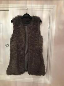 Grey/mink colour sleeveless fur jacket