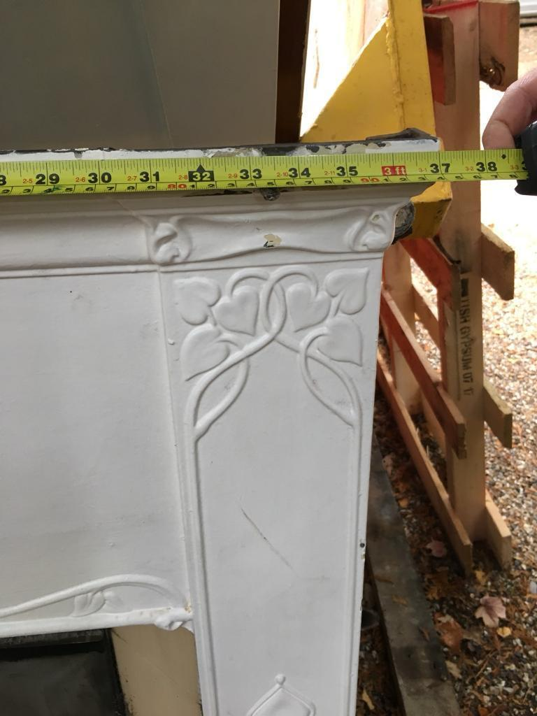 White cast iron fireplace and surround