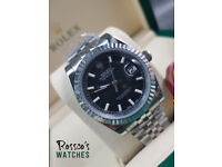 Rolex Datejust. Silver Bracelet with black face. Includes Rolex Box and Paperwork.
