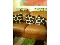 Two seater leather sofas
