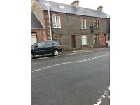 Four one- bed flats to let in one block in Darvel