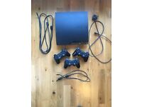 PS3 Bundle, includes 3 wireless controllers, 20 games
