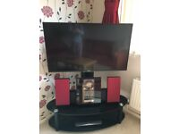 Two Tier Oval Glass TV Stand