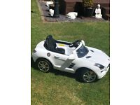 Kids Mercedes electric car SLS AMG White, plays music, the lights work spare battery