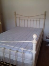 Cream metal king size bed and mattress