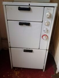 old vintage Tricity cooker for a prop or display can deliver