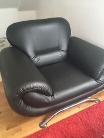 Black leather armchair in excellent condition