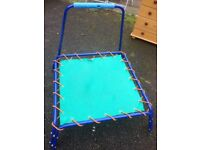Toddler trampoline with hand rail