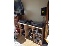 2x Technics 1210 mk2 turntables, 1x reloop RMX33i 3 channel mixer, 2x Rokit 5 speakers, DJ table