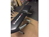 Exercise bench ideal for sit ups weights and stretching.