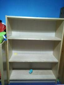 A shelf in an excellent condition with a free wardrobe
