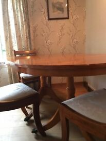Dining room table and chairs, 2 carvers. has extending section to sit eight people.
