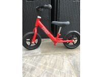 Childrens balance bike - from 18 months upwards - assists in future bike riding - red