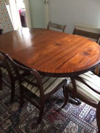 Extending Oval dining table and six chairs