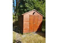 Wooden garden shed (8 x 16 ft)