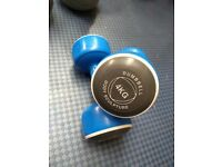 Selection of kettle bells, dumbbells, a barbell, medicine ball, agility ladder, steps