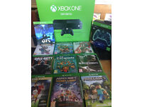 latest version of xbox one excellent condition includes aftershock remote and 9 games 1 download